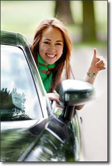 Girl in car giving thumbs up. Photo © Andres Rodriguez