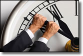 man turning back hands on a clock